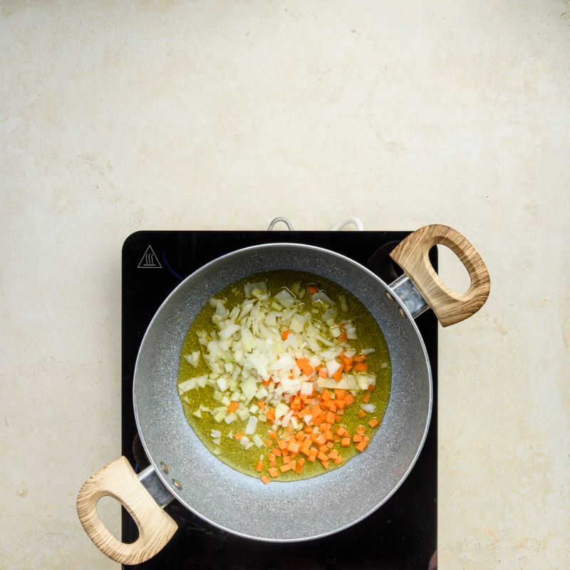 celery, carrot and onion in a large saucepan with olive extravirgin oil