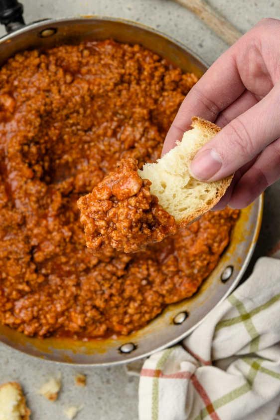 ragu sauce with a piece of bread