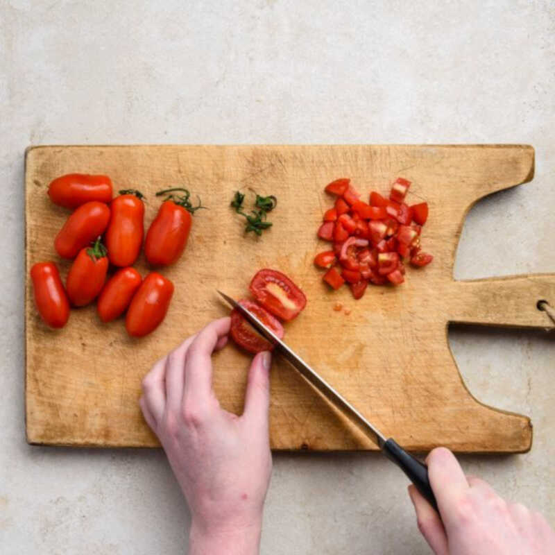 Finely and evenly dice the tomatoes