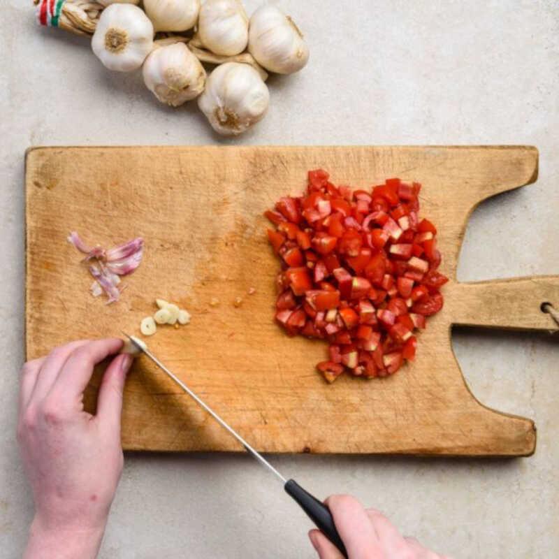 Thinly slice one garlic clove