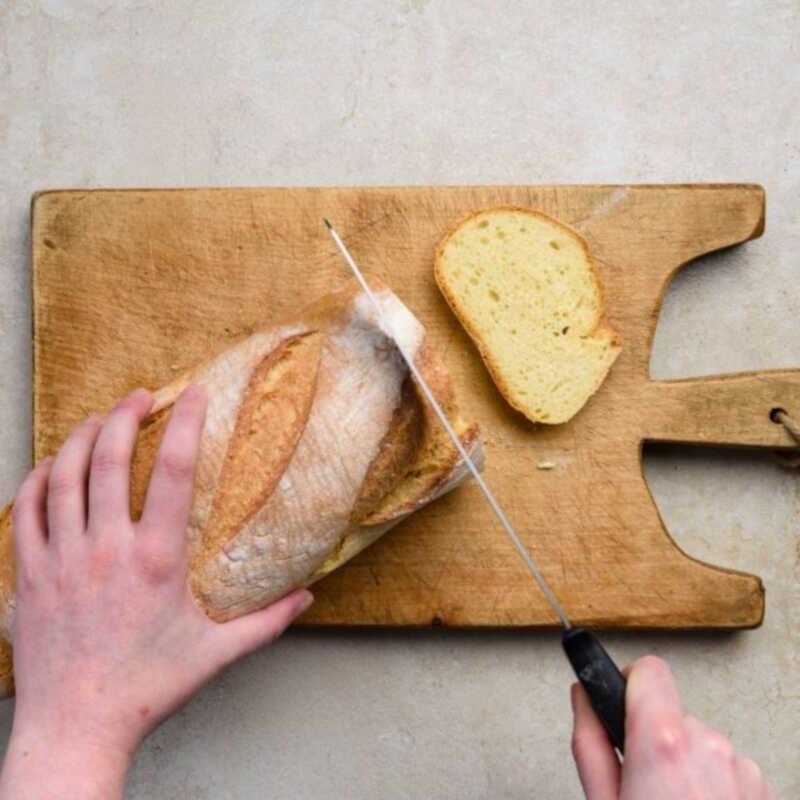 To make tomato bruschetta, super tasty italian recipes, slice the loaf into 1.5 cm pieces