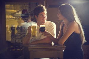 man-and-girl-drinking-beer-in-a-bar