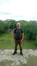 Standing atop the Jaguar Temple at Lamanai.