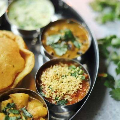 Tomato-Sev Curry and Black eyed peas and Spinach Curry (in a Gujarati Thali )