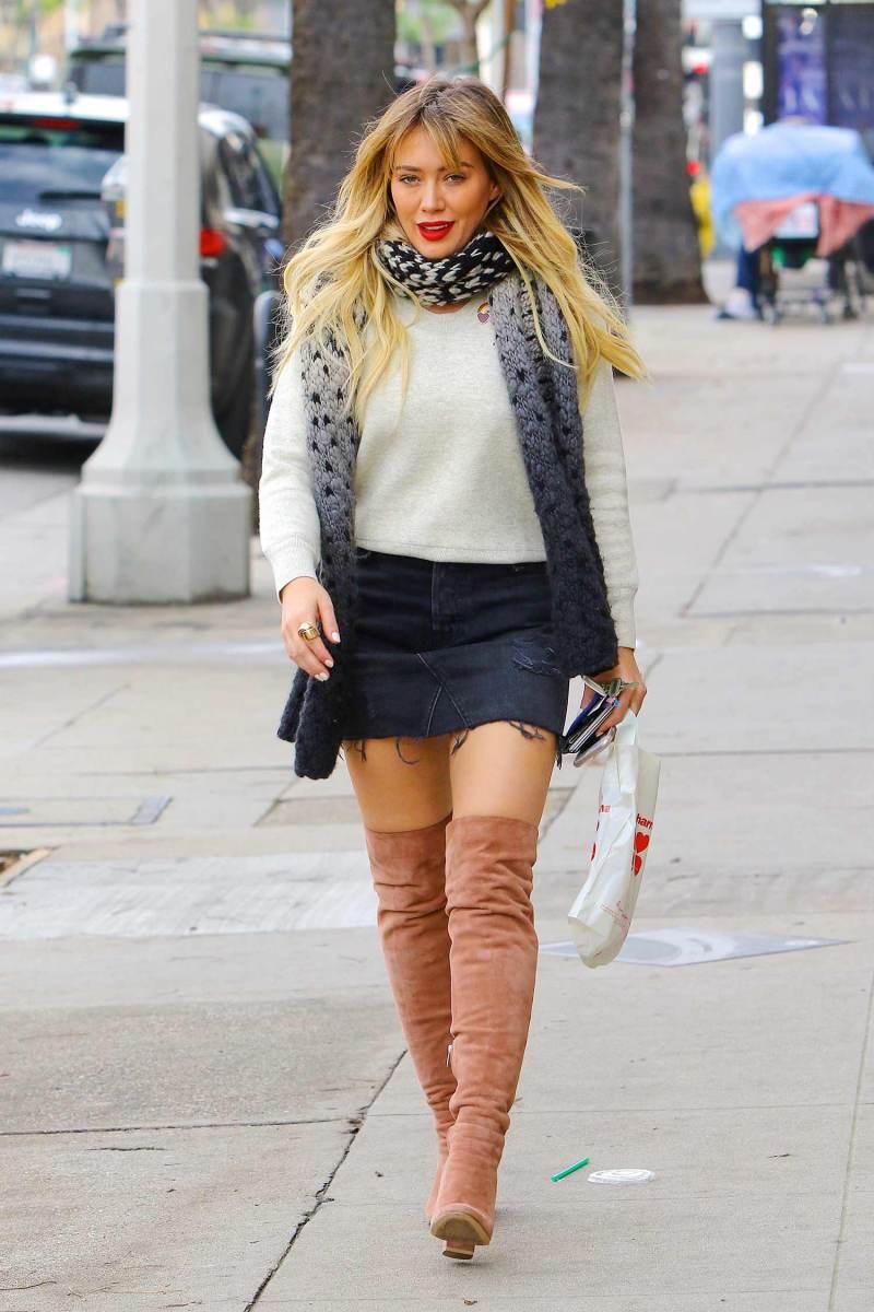 6e6bb243e7 Hilary Duff Rocks A Denim Mini Skirt With Over The Knee Boots