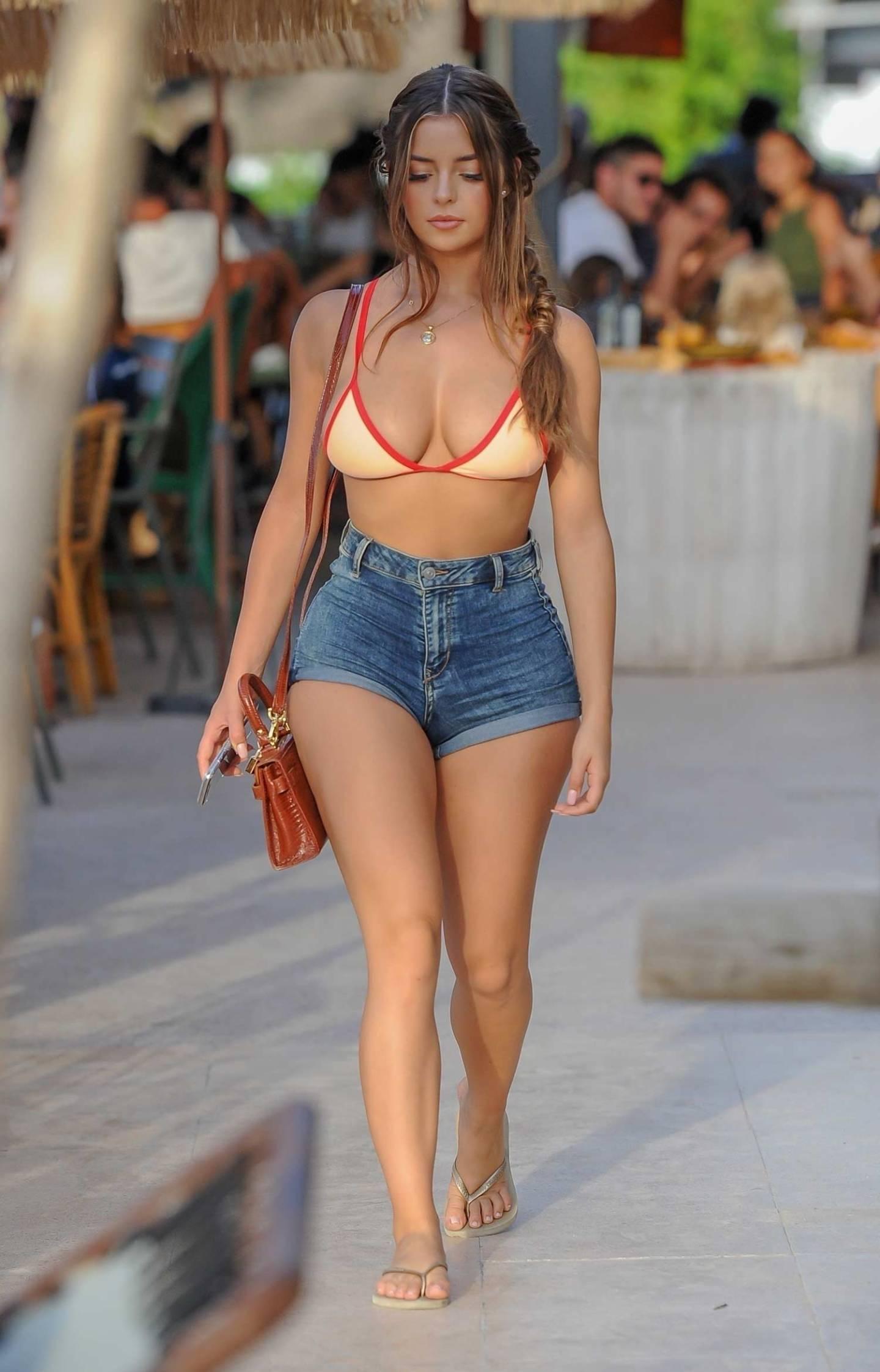 Demi Rose Wears Denim Shorts