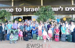 Group photo of the Olim right after landing.Photo Credit: Sasson Tiram, courtesy of Nefesh B'Nefesh.