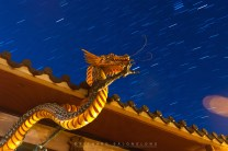 2: The dragon figure hangs on a roof of an entrance arch of the Bell Church in Baguio City as stars backdrops the moonlit night skies.