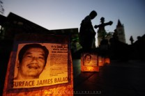 25: Lighted candles on paper bag with James Balao's picture on it is seen glowing in front of the Baguio Cathedral as members of Cordillera Peoples Alliance (CPA) and relatives of James held a candle lighting and offered a prayer in commemoration of James' 1312th day of forced disappearance and his 51st birthday. James Balao, an active member of the CPA, was abducted last September 17, 2008 and still missing until now.