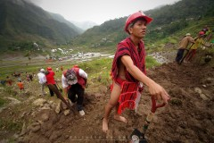 8: 7: A man wearing his full traditional garb helps, along with visiting volunteer groups, in the effort to restore the Batad Rice Terraces in Ifugao in Mountain Province damaged by recent typhoons and landslides.