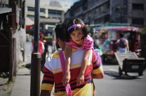 23: HANGING AROUND WITH DAD. A father is seen carrying his daughter along Magsaysay Avenue in Baguio City early morning.