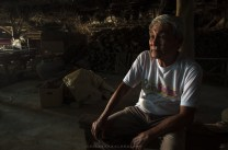 Fidel Go, 76yrs old, one of the last original clay potter in Vigan City, Ilocos Sur, Philippines sits inside his work area. Clay pottery is one of the dying industry in the city as plastic wares are being replaced in most houses in the country.