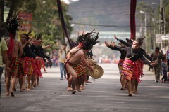 An indigenous group in their full traditional garbs dances along the road of La Trinidad in Benguet during the celebration of Strawberry Festival.