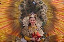 A participant in Vigan City's Binatbatan World Costume Festival wears a costume representing Cebu's Sinulog Festival during the street parade on Calle Crisologo in the capital city of Ilocos Sur.