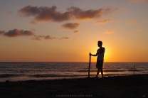 A man is seen talking someone from his mobile phone at the beach of Mina De Oro in Vigan City, Ilocos Sur.