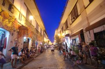Tourists and locals crowds the cobble-stoned streets of the old Spanish-era community in Vigan City, Ilocos Sur during dusk.