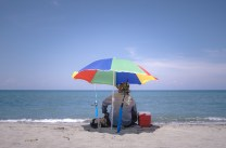 A man sits quietly along the beach of Mina De Oro in Vigan City, Ilocos Sur, awaits for a long period of to hoping to catch a fish.