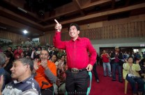 Nicasio Aliping Jr. gestures after he was announced for winning the campaign election for representative of Baguio City.