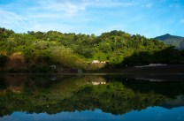 An operational tailings dam of a mining company in Mankayan in Benguet is seen during sunrise.
