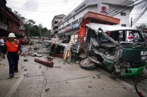 A member of the Benguet Electrical Company is seen at the accident site where a ten-wheeler truck losses its break and smashes to an electrical post, a building, and a pick-up truck along Bokawkan Road in Baguio City.