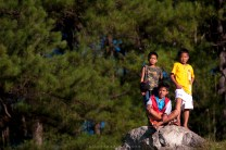 Children are seen taking a break on top of a rock near the golf course in Mankayan, Benguet.
