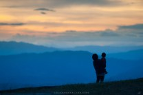 A mother and her child are seen sightseeing at a viewpoint of an airstrip of a mining company in Mankayan, Benguet.