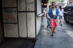 """Elder in a traditional g-string attire or """"bahag"""" at the streets of Bontoc in Mountain Province."""