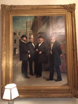 The man on the right was much taller than the other three gentleman in the picture so he was drawn closer to the artist's perspective. This painting depicts the four leaders of the Memphis community and the corner they typically converged at to discuss important matters.