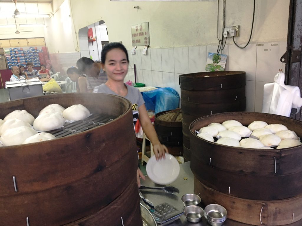 A cafe worker making pau