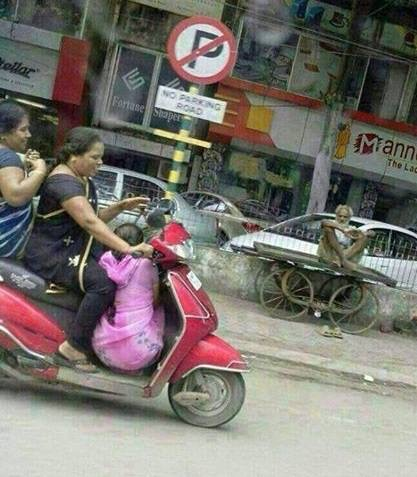 Child riding dangerously in India
