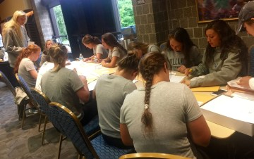 Still more of Villanova University's women's field hockey team writng letters to Philadlephia area schools suggesting a sock drive for the homeless as a school community service project.