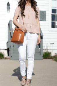 White jeans pink top