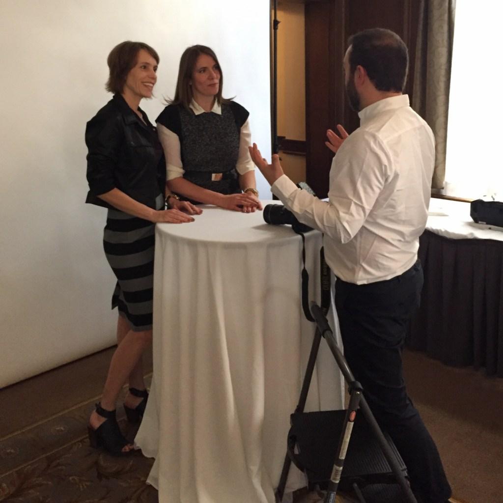 Entrepreneurs talking to photographer