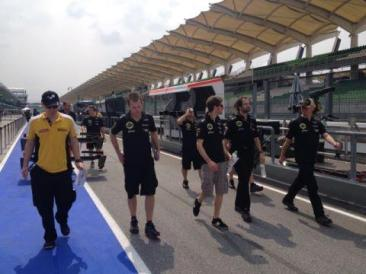 Lotus lads having a late start? RG and DV walking the track but no Kimi