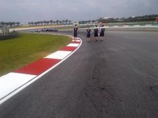 Flat out now through exit and on to 12