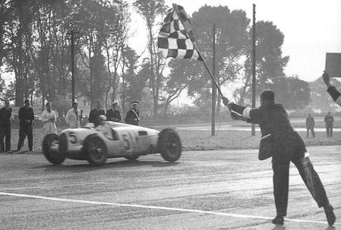 Rosemeyer receiving the chequered flag at Donington, 1937