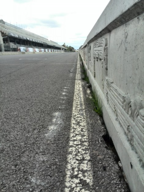 The barrier that separates the main straight and pit lane