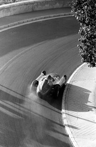 Fangio drifting his Ferrari through Mirabeau