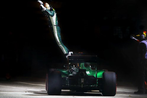 Kamui Kobayashi leaps clear of his car after pulling up on the formation lap