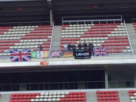 Some Lewis Hamilton fans filter into the grandstand,though they remain mostly empty for the moment