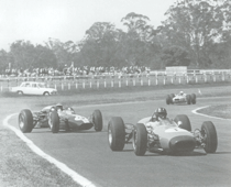 A crossed up Jim Clark chasing Graham Hill at Warwick Farm