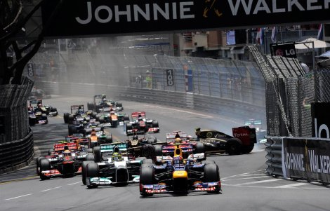 Mark-Webber-AUS-Red-Bull-Racing-RB8-leads-as-Romain-Grosjean-FRA-Lotus-E20-crashes-out-at-the-start-of-the-race.-Formula-One-World-Championship-Rd6-Monaco-Grand-Prix-Race-Day-Monte-Carlo-Monaco-Sunday-27-May-2012