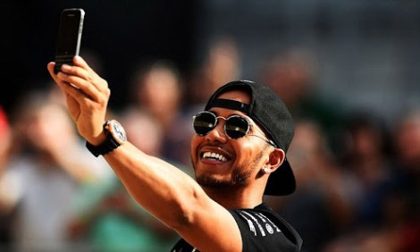 AUSTIN, TX - OCTOBER 22:  Lewis Hamilton of Great Britain and Mercedes GP takes a selfie in the pit lane after an autograph session during previews to the United States Formula One Grand Prix at Circuit of The Americas on October 22, 2015 in Austin, United States.  (Photo by Lars Baron/Getty Images)