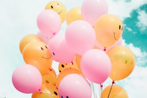 Smiling balloons of positivity
