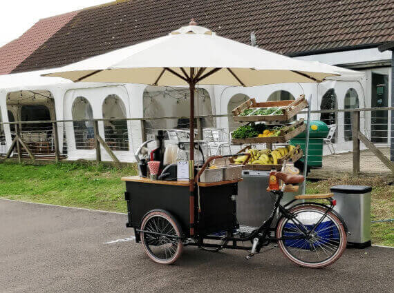 smoothie bike with umbrella for outdoor event
