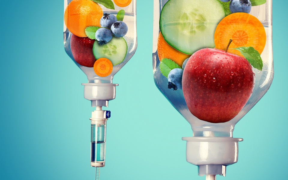 Nutritional intravenous services available from The Karlfeldt Center. Serving Boise and Meridian, Idaho. Image of two bottles suspended upside-down with fruit shown inside.