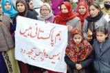 Wives of ex-militants stage demos on demand for return to their homes in Pakistan