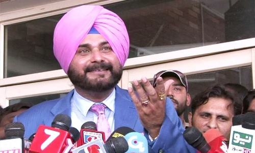 In Pak for Imran Khan's swearing in, Sidhu bats skilfully with media
