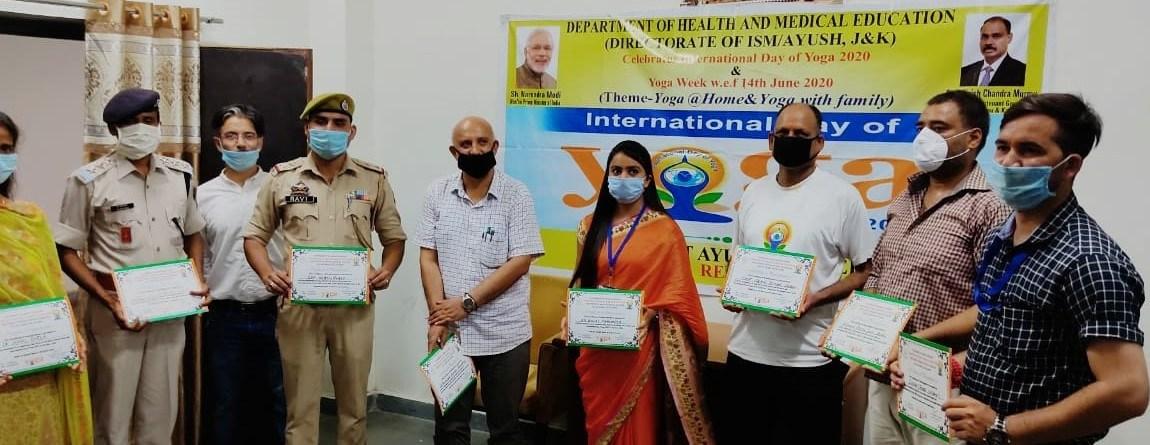 ISM felicitates participants, coordinators of International Yoga day at Reasi