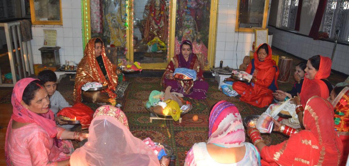 DEVOTION ULTIMATE Women performing rituals…